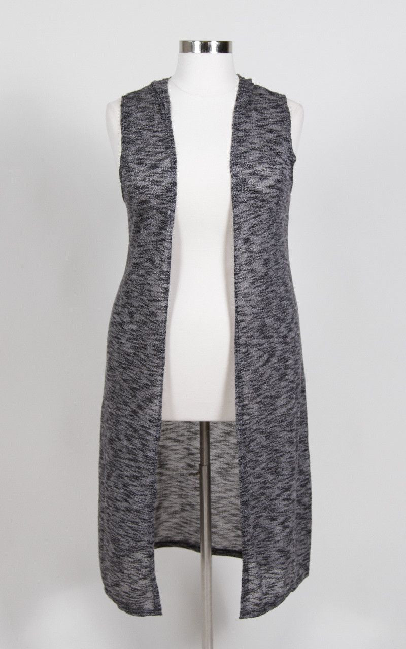 Grey tone hooded vest. 63% Rayon, 33% Polyester, 4% Spandex Hand wash Hang or line dry Made in U.S.A Love the whole look? Click the links below! Ameowz Fall Mini Skirt Faux Leather Keyhole Top - Black Length Arm hole Size: 14/16 40.5