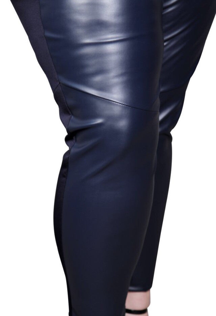 The most luxurious legging we have ever made includes a moto detail around the legs. The thick waistband is all scuba making the waist very comfortable. This thick, scuba material has a slight stretch, and is made of: 95% Polyester 5% Spandex The faux leather accents are made of 100% Polyester. Machine wash cold and tumble in a cool dryer.