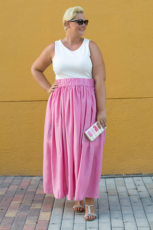 Designed by our Creative Director & Co-Founder Jessica Kane, this skirt is the ultimate for any woman on the go who wants to feel put together and comfortable! No wonder every color we release sells out! This skirt is made of the same material as the Margarita and Ruby Romance which is a super light polyester fabric. It won't stick to you or get static easily which we find to be great perks. And, did we mention it has pockets?! YEP! Manufactured By Society+ Compostion 100% polyester Waistband 3