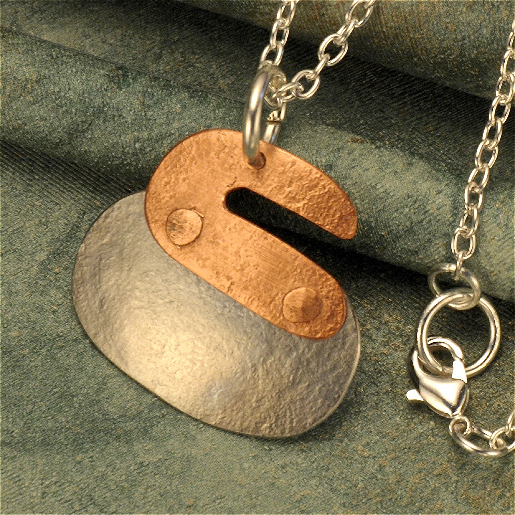Curling rock two-tone necklace