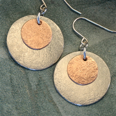 Round two-tone earrings