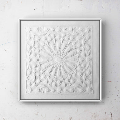 Framed Artwork by British-Bengali Textile Fine Artist, Jennifa Chowdhury. Intricate white Laser Cut Textile pieces layered to create a geometric design inspired by traditional Islamic Art.