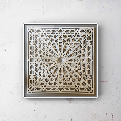 Framed Artwork by British-Bengali Textile Fine Artist, Jennifa Chowdhury. Intricate white Laser Cut Textile Design, inspired by the geometric patterns used in traditional Islamic Art.