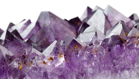 close-up high definition photo of a glimmering purple amethyst geode