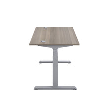 Load image into Gallery viewer, Grey Oak Glide Height Adjustable Desk, Silver Frame, Side View