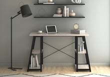 Load image into Gallery viewer, Odell black frame desk with floor lamp, shelves in home work space