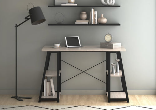 Odell black frame desk with floor lamp, shelves in home work space