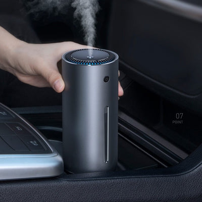 a person using the humidifier in his car