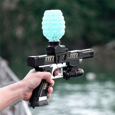 a person aiming the water gun