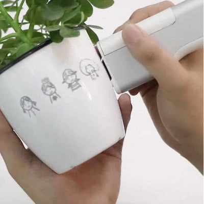 using handheld printer on a flower pot
