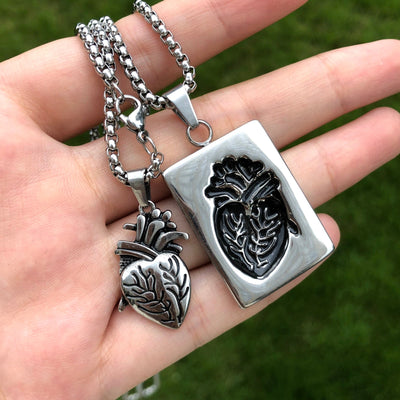 a girl holding the heart locket