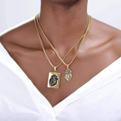 a woman wearing the heart locket golden colour