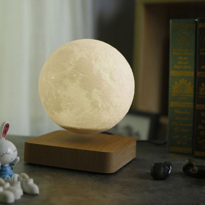 levitating moon lamp with brown coloured base