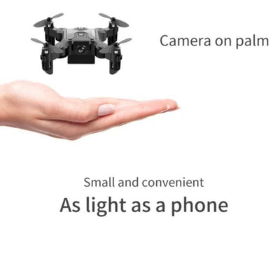 Mini drone flying above a person's palm