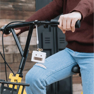 mini bluetooth speaker being tied to a bicycle