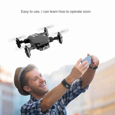 a man flying the mini drone