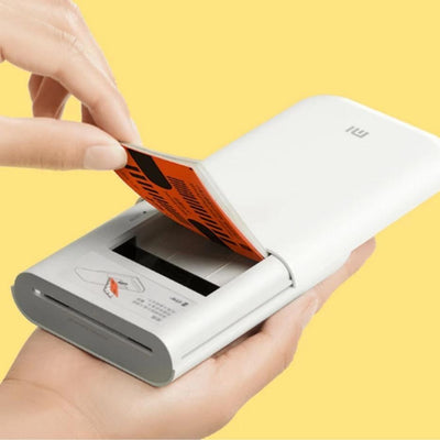 putting thermal paper in the portable printer