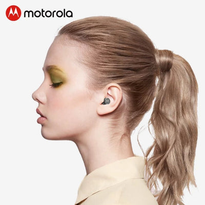 A girl wearing Motorola earbuds