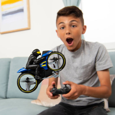 a kid flying the remote control motorcycle