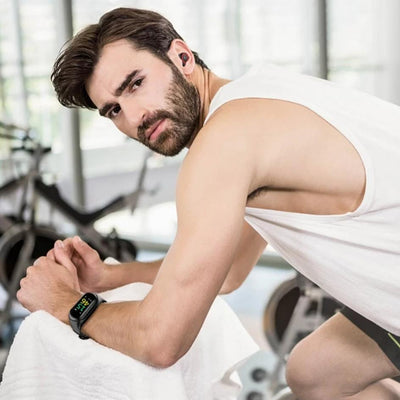 a man wearing the smartwatch at gym