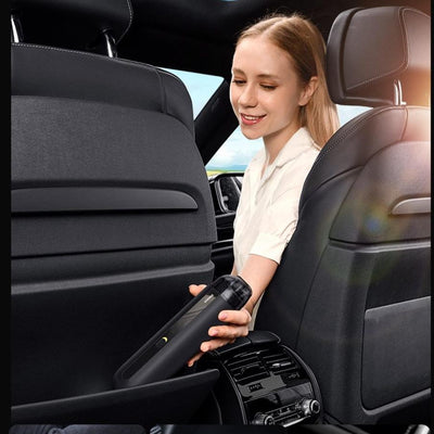 a girl using the vacuum cleaner for car