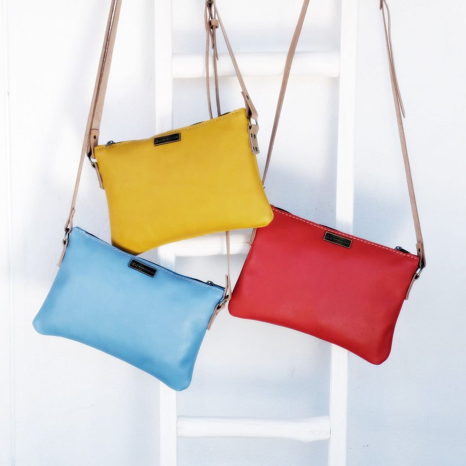 Leather sling bags various colours