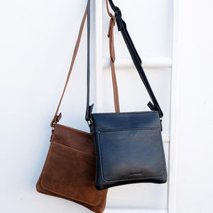 Cross over black and brown leather satchels