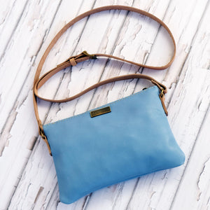 Light blue leather casual sling bag.
