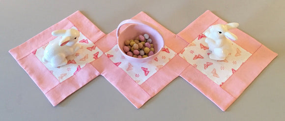 hand-stitched linen table runner with spring decor.