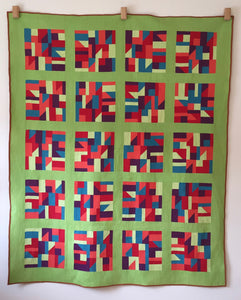 modern quilt in primary colours with lime green sashing and borders.
