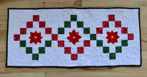 table runner with red and green twist with poinsettia applique.