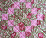 close up of diagonal line quilting on quilted table runner.