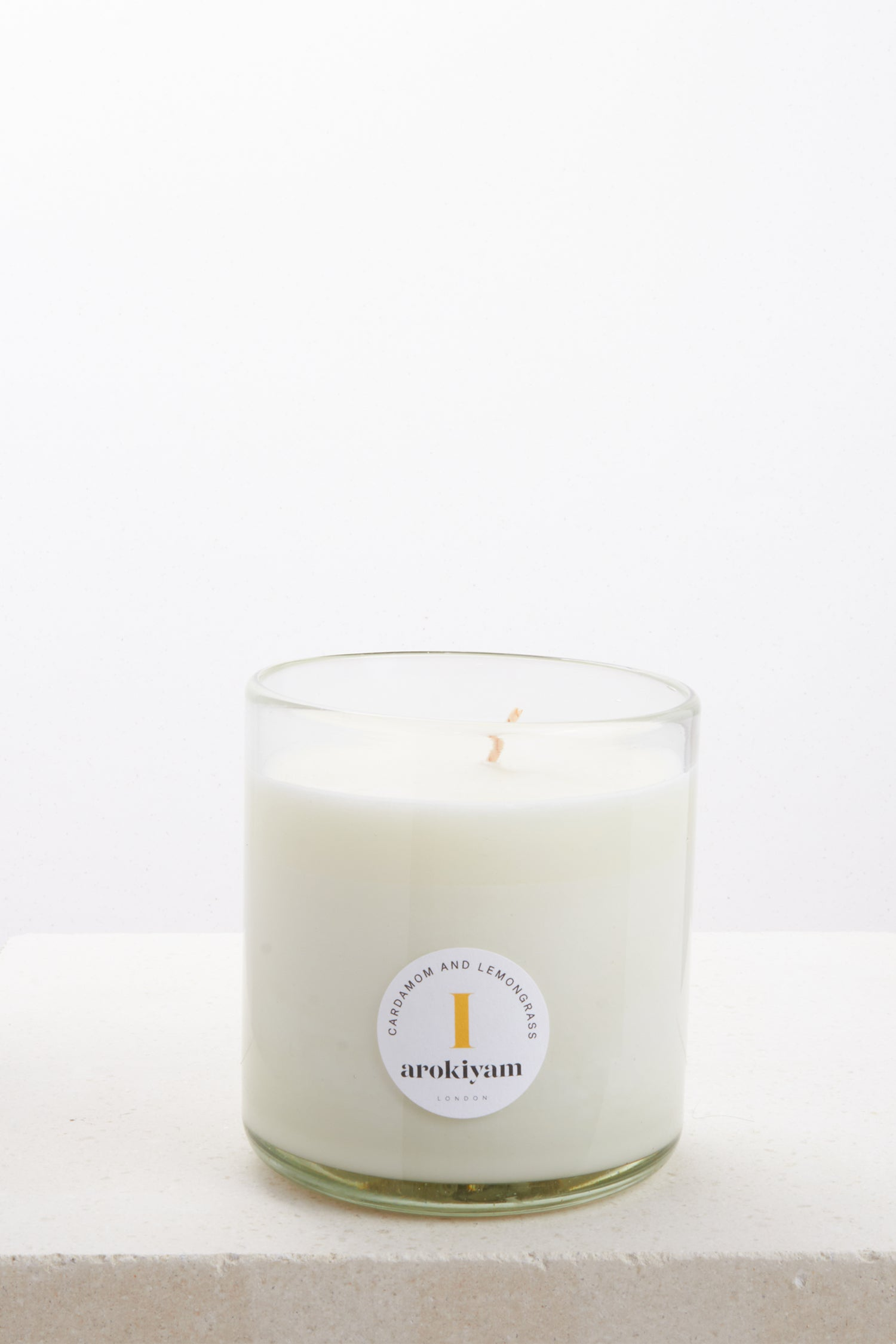 Vegan candle made from a coconut and soy wax and scented with natural cardamom and lemongrass. Made in London.