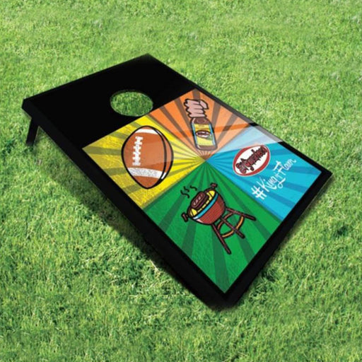 Tailgating Cornhole Game Set featuring the El Yucateco Logo, and graphics of sports, hot sauce bottles, and grilling on a grassy field