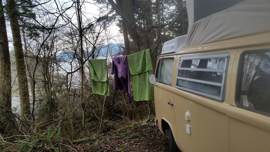 VW bus with towels in the woods