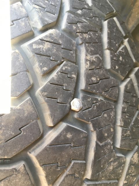 Bolt embedded in tire