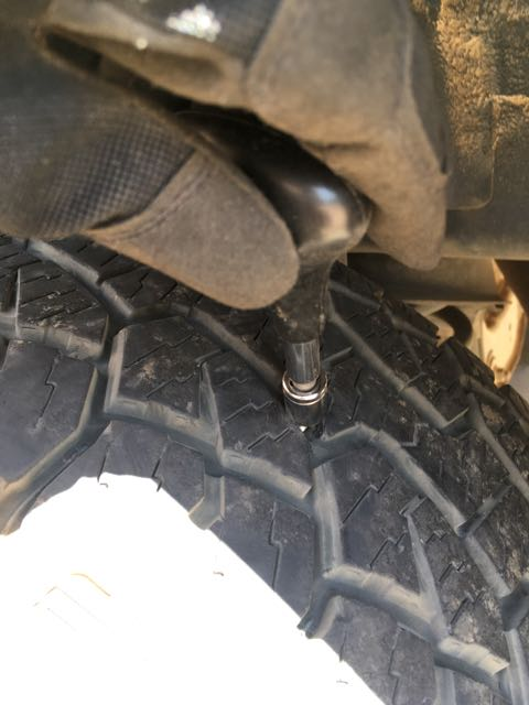 Removing a bolt from a tire