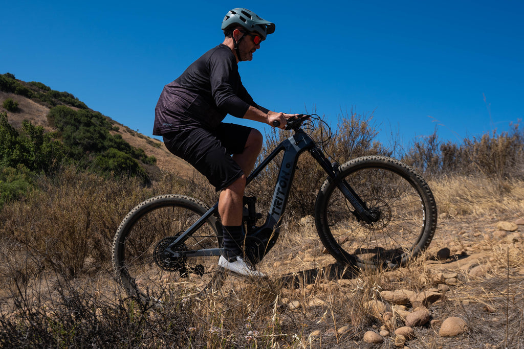 Triton Ares Electric Mountain Bike featuring professional rider