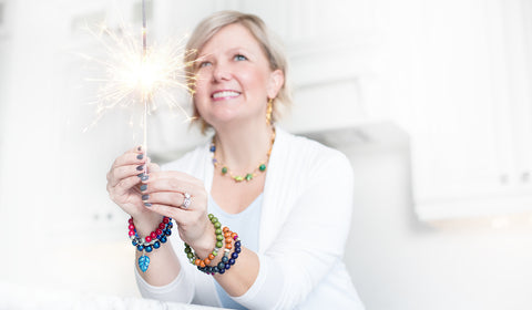 Kristen Edmiston, jewelry designer wearing bracelets and necklaces that she makes and sells.