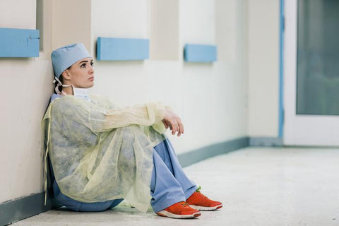 Doctor sitting on floor