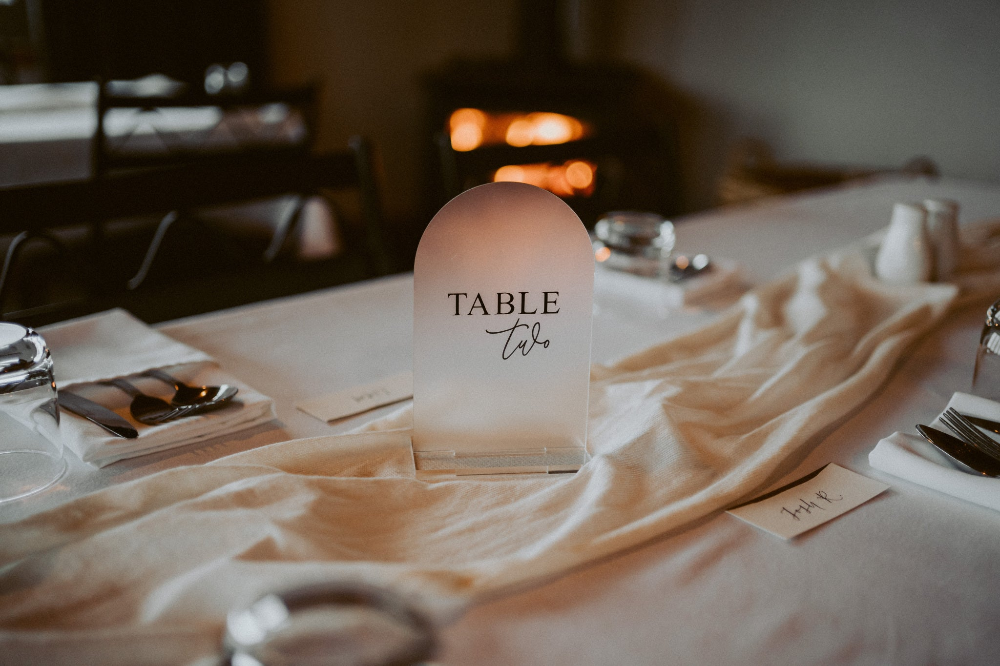 Lily + Josh | Frosted Acrylic Table Number Arch Shape | The Paper Gazelle Wedding Feature