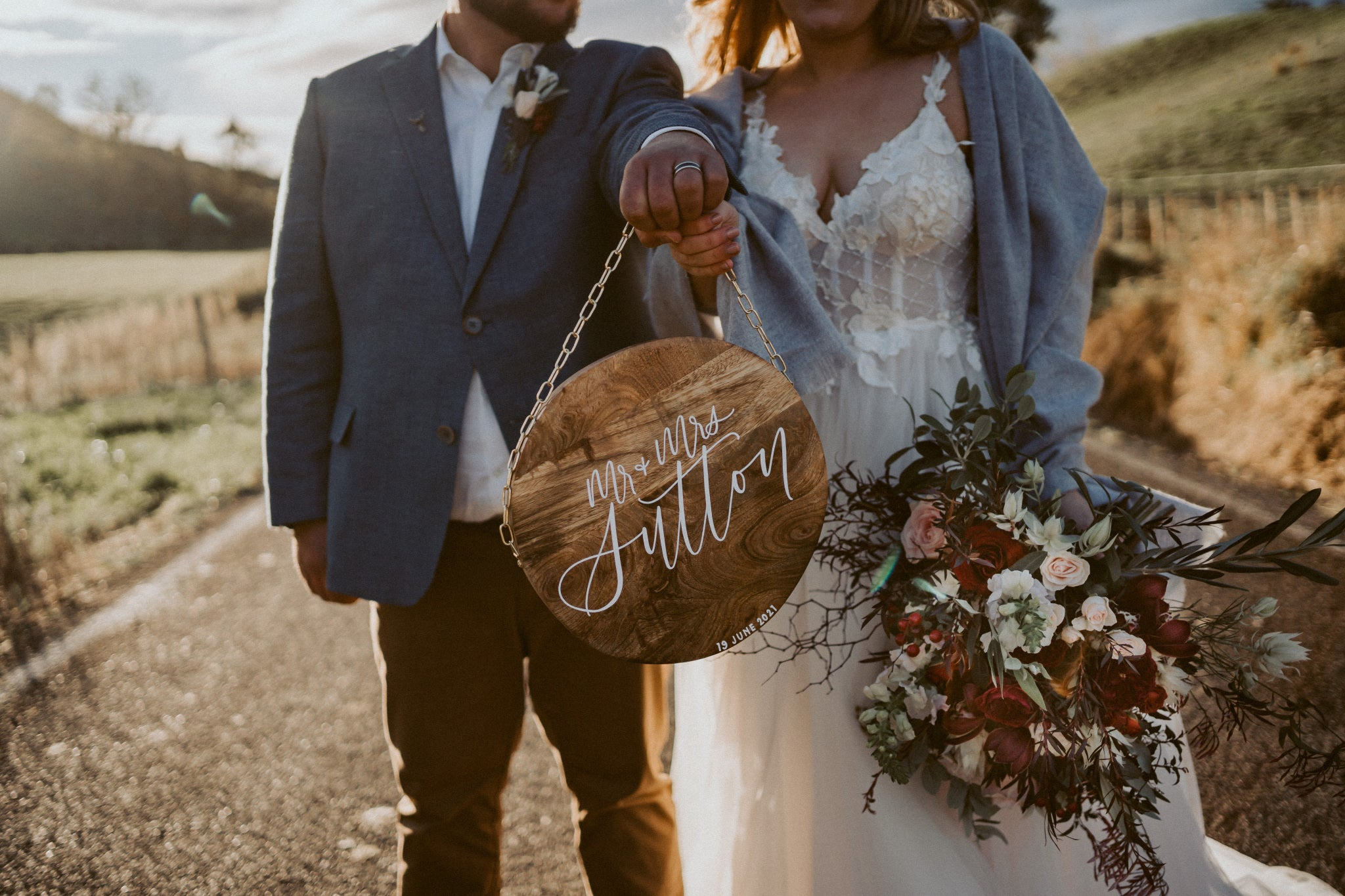 Lily + Josh | Newlywed wood name plaque sign | The Paper Gazelle Wedding Feature