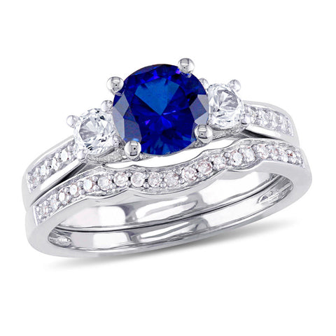 6.0mm Lab-Created Blue and White Sapphire with 1/8 CT. T.W. Diamond Three Stone Bridal Engagement Ring Set in 14K White Gold