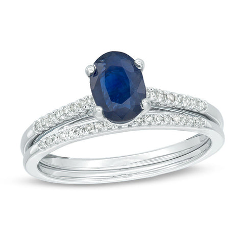 Oval-Shaped Blue Sapphire and 1/8 CT. T.W. Diamond Bridal Engagement Ring Set in 14K White Gold