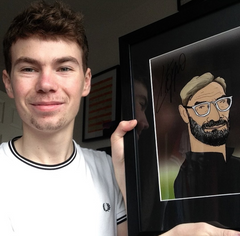Josh with signed caricature of Jurgen Klopp Liverpool FC manager