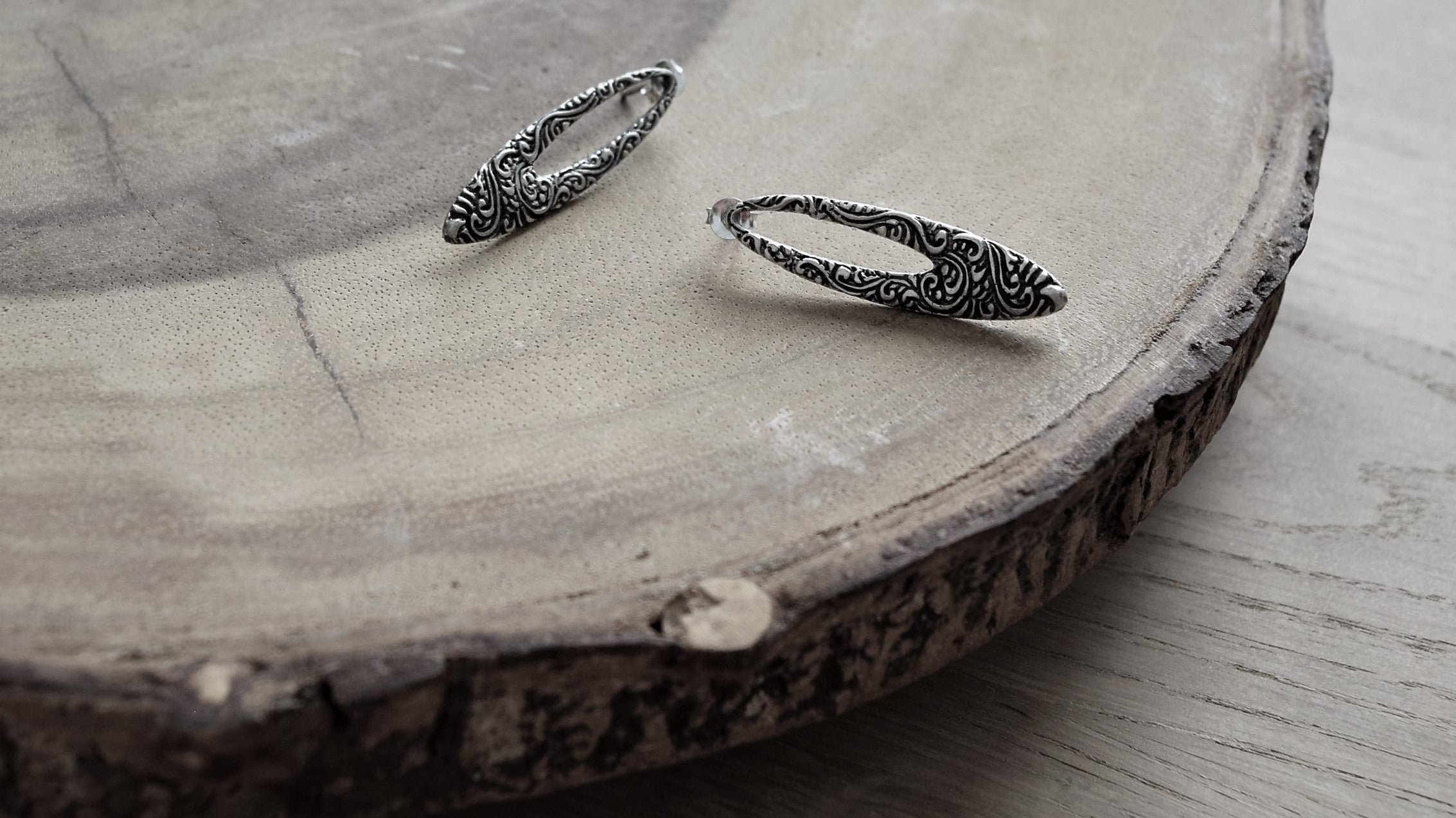 Shop online for gift for Chinese New Year and Valentine's Day: simple elegant oval shaped silver earrings with intricate patterns designed in Singapore, handmade in Bali.