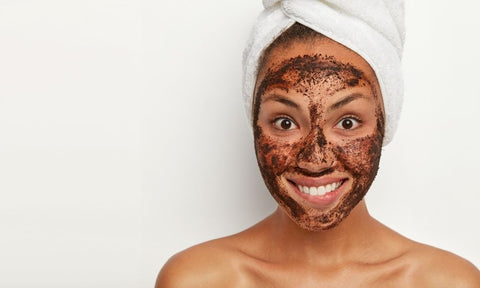 Woman with coffee scrub on face