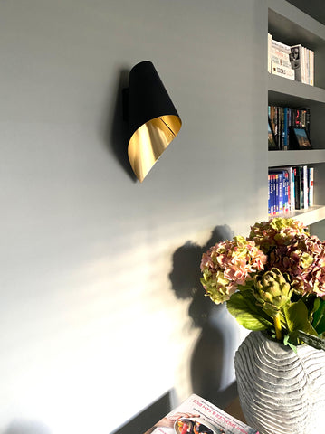 wall light in black and brushed brass