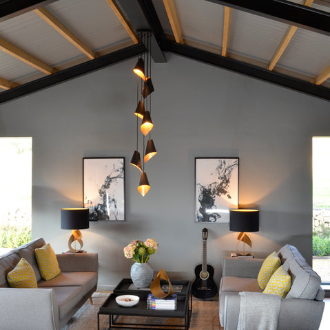 large pendant cluster light in room with high ceilings