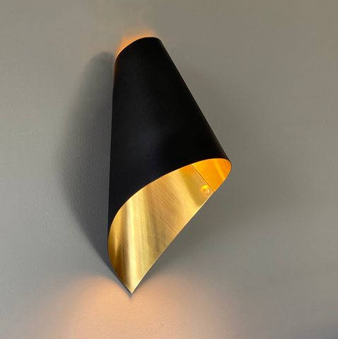 black and brushed brass wall light
